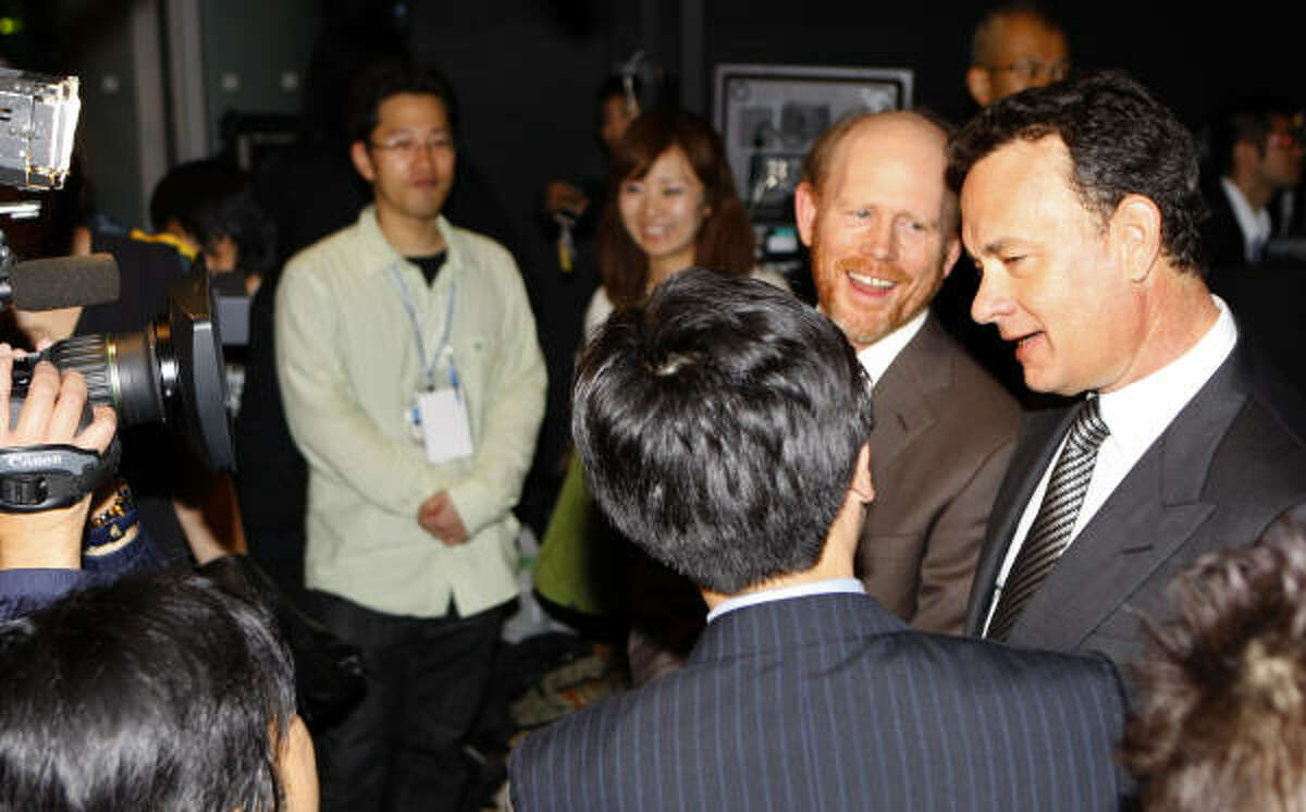 Tom Hanks, right, and director Ron Howard answer a questions.