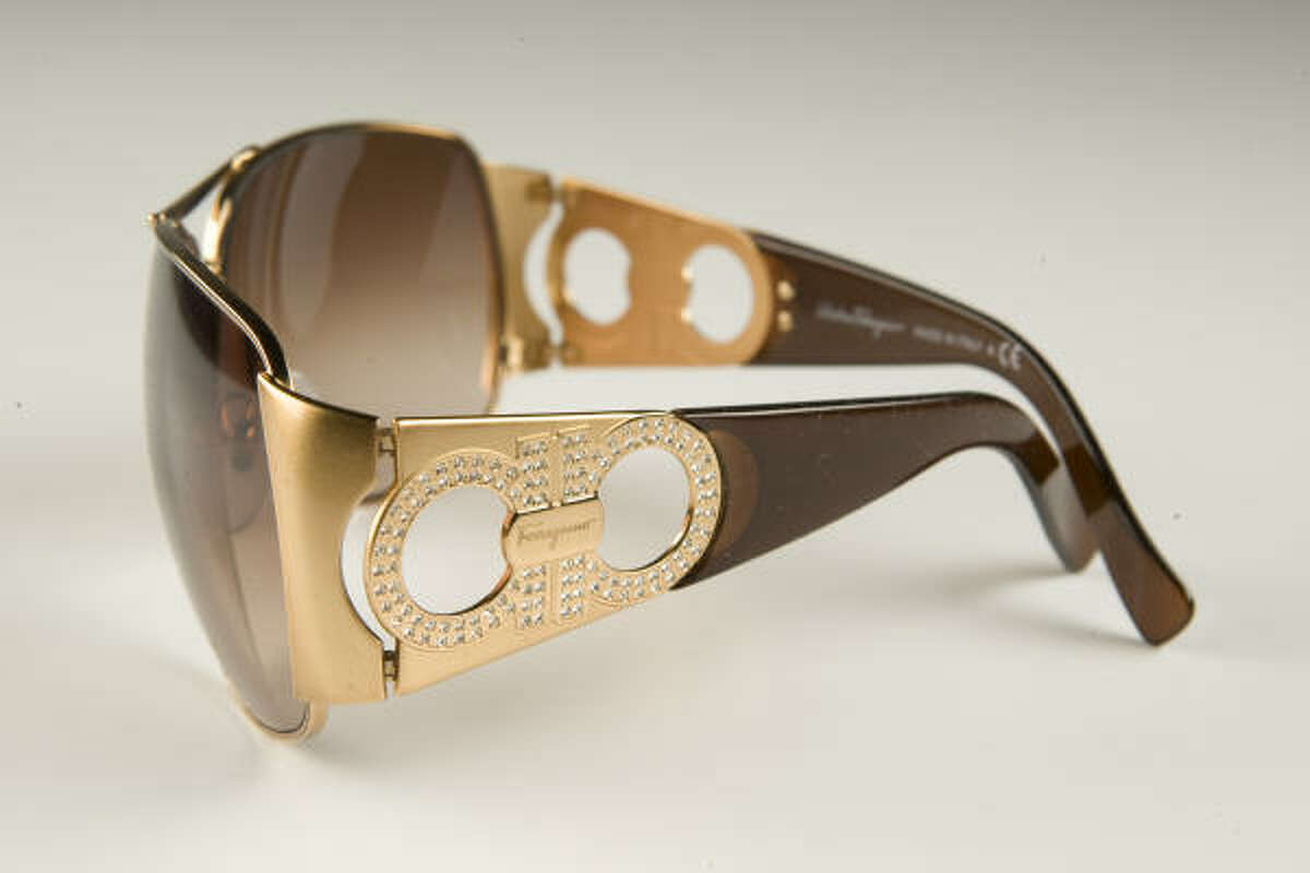 New sunglasses from Ferragamo, have a cut-out rhinestone pattern on the temples; $355, Ferragamo Boutique, the Galleria.