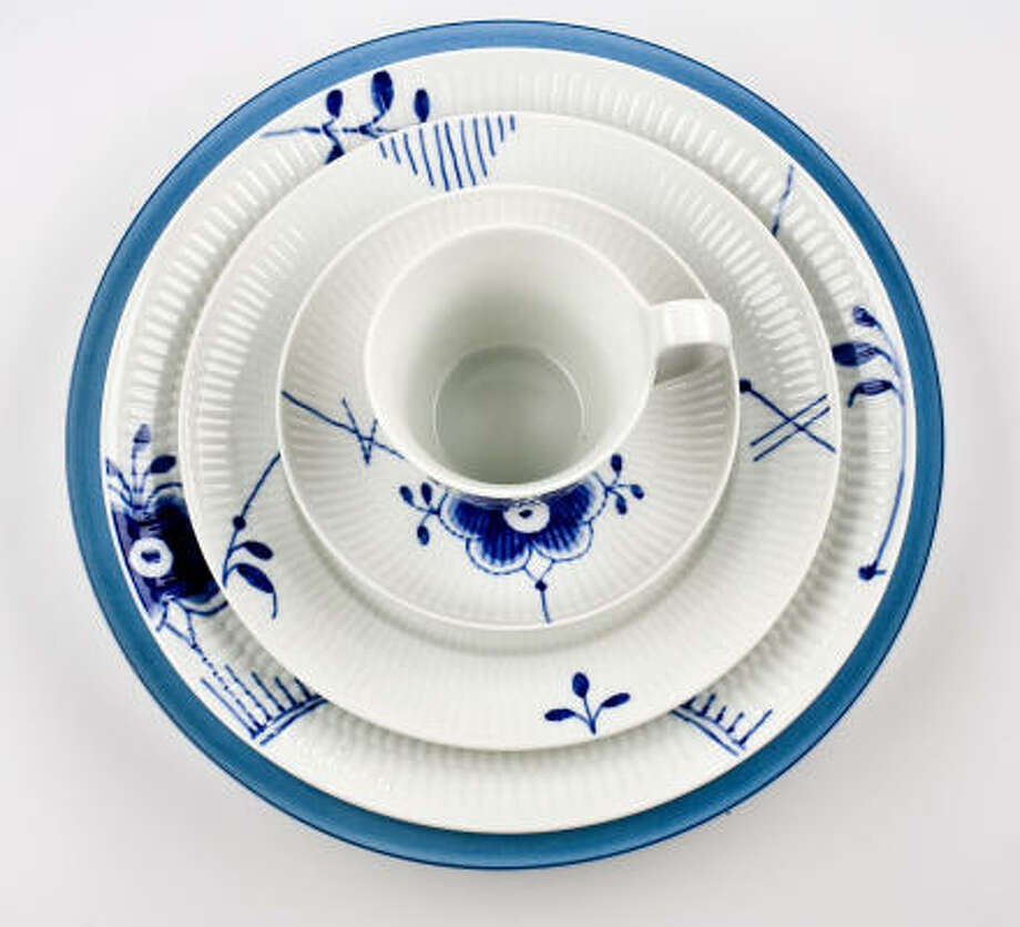 Royal Copenhagen Blue Fluted Mega four-piece place setting, $350, and Pareo charger by Raynaud, $92, at Kuhl-Linscomb. Photo: Karen Warren, Houston Chronicle