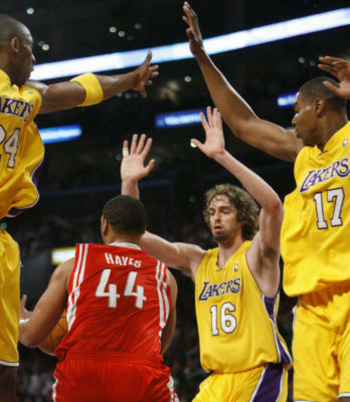 Chuck Hayes is surrounded by a host of Laker defenders after collecting a rebound in the first half.