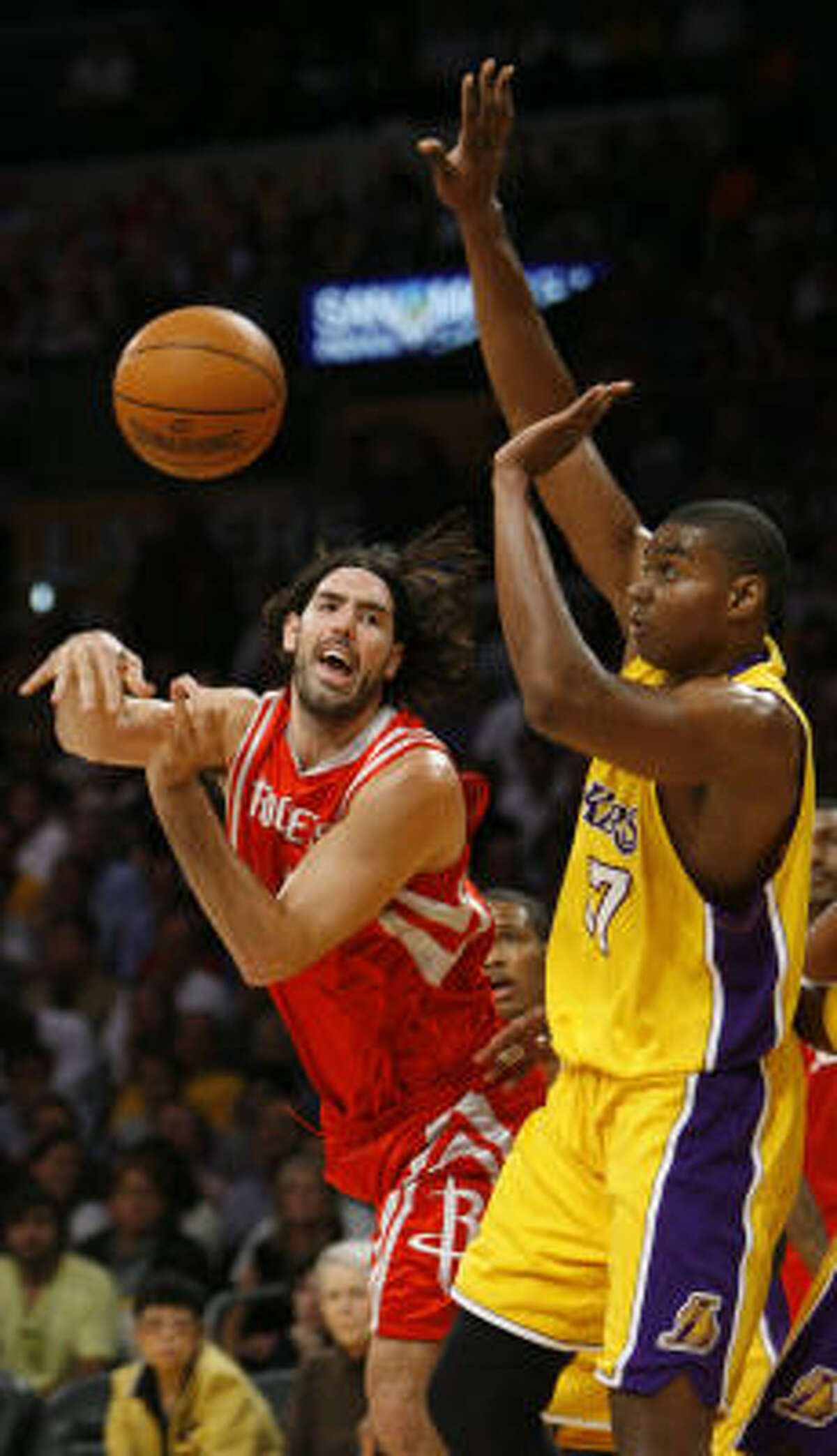 Luis Scola, left, looks for the open man opposite Lakers center Andrew Bynum in the first half.
