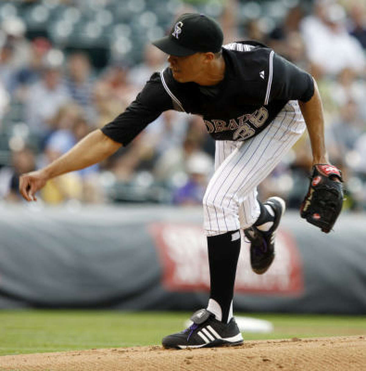 Rockies starter Ubaldo Jimenez works against the top of the Astros' lineup in the first inning.