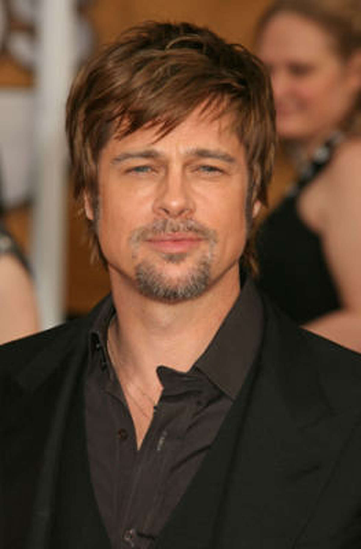 Leave it to Brad Pitt to find an incredibly manly way to rock bangs, by simply pairing with a sexy salt-and-pepper goatee. Angelina Jolie must love that.