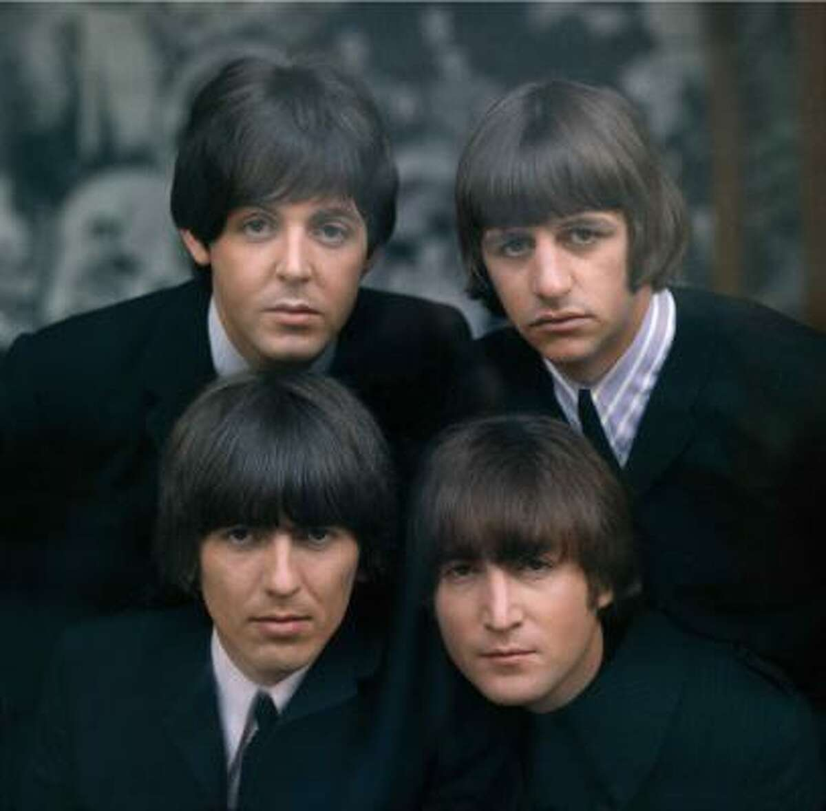 The Beatles' British Invasion music also made fans of their boy bangs look.