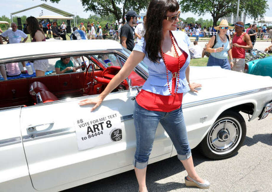 Heidi models next to an Art Car Parade vehicle. Photo: Chris Elliott