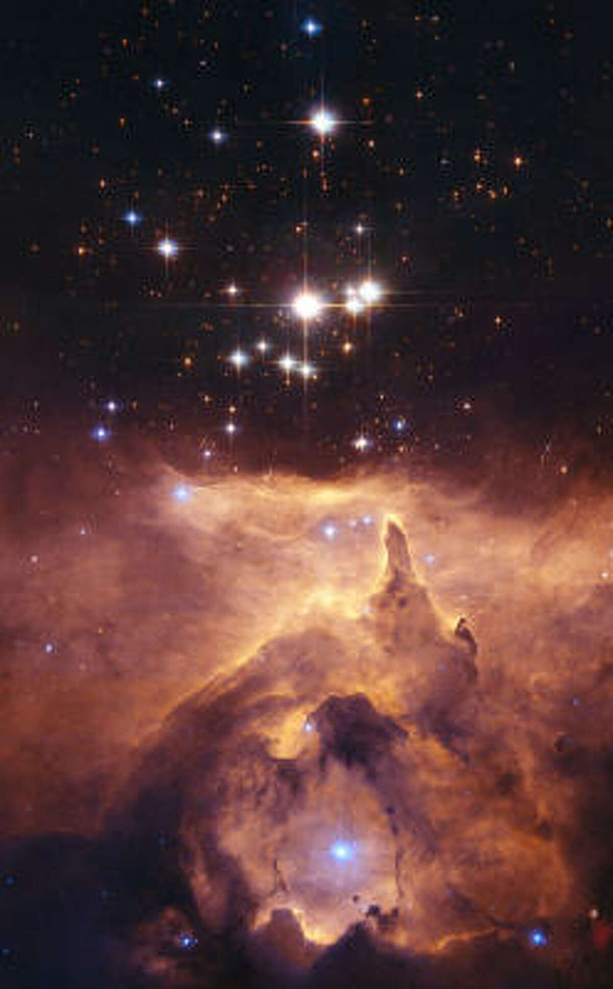This photo, supplied by NASA and the European Space Agency on Monday, Dec. 11, 2006, shows Pismis 24-1, a bright young star that lies in the core of the small open star cluster Pismis 24, the bright stars in this Hubble Space Telescope image.
