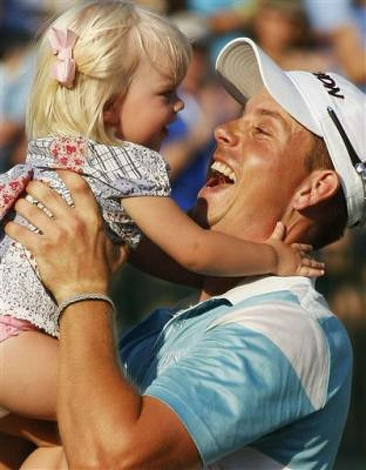 Henrik Stenson of Sweden celebrates his four-shot victory at The Players Championship with his daughter Lisa on Sunday at TPC Sawgrass in Ponte Vedra Beach, Fla.