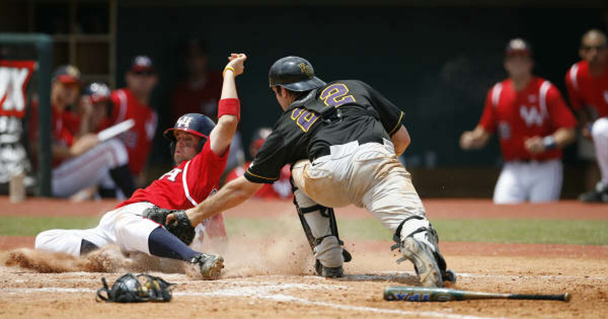 UH's David Murphy is called out at the plate on a tag by East Carolina catcher Jared Achen in the bottom of the third inning.