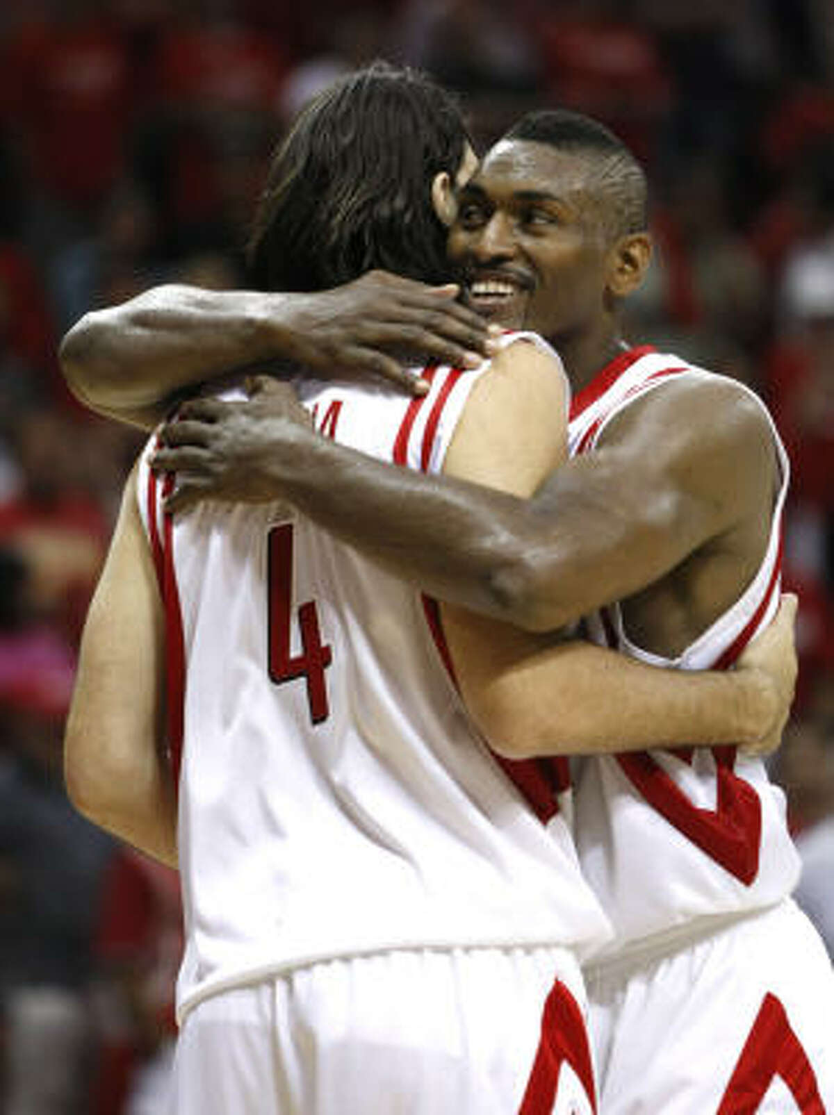 Rockets forward Luis Scola and Rockets guard Ron Artest embrace near the end of the fourth quarter.