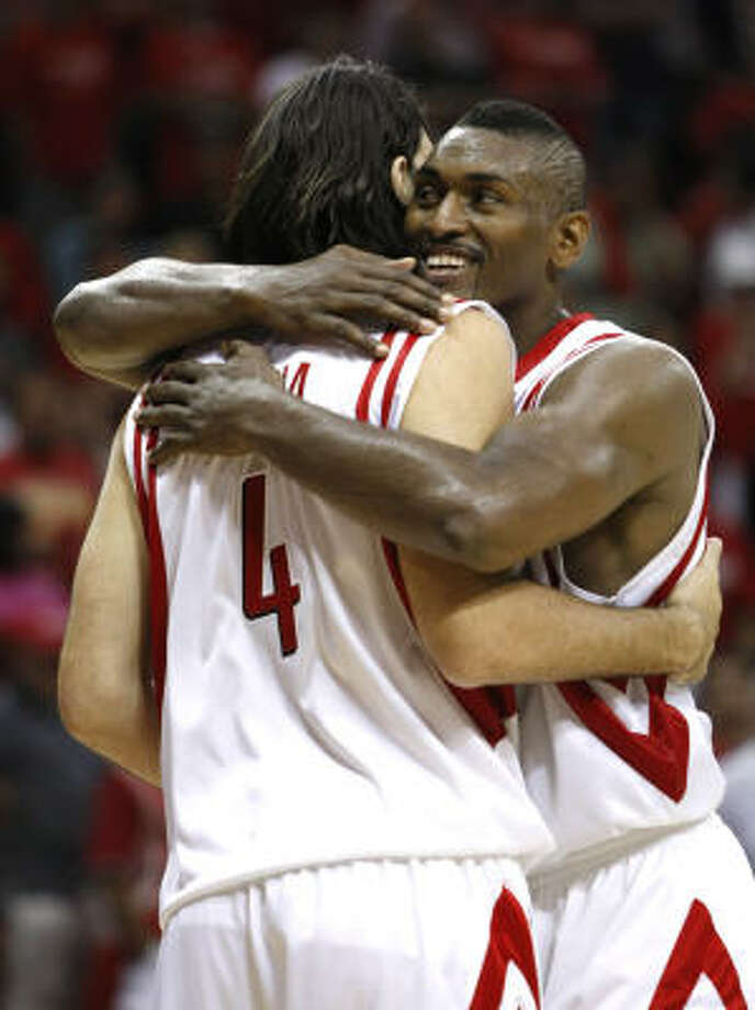 Rockets forward Luis Scola and Rockets guard Ron Artest embrace near the end of the fourth quarter. Photo: Brett Coomer, Chronicle