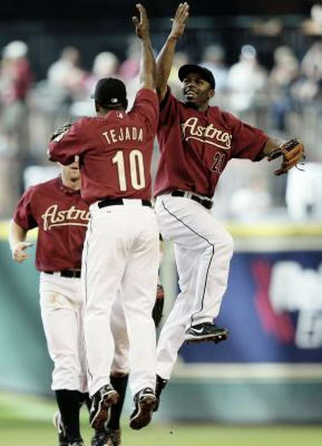 Astros shortstop Miguel Tejada (10) and Michael Bourn (21) celebrate after the final out of the series against the Padres. Photo: Bob Levey, AP