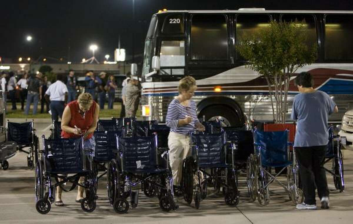 Wheelchairs are assembled before a group of WWll veterans were taken from Conroe to George Bush Intercontinental Airport.