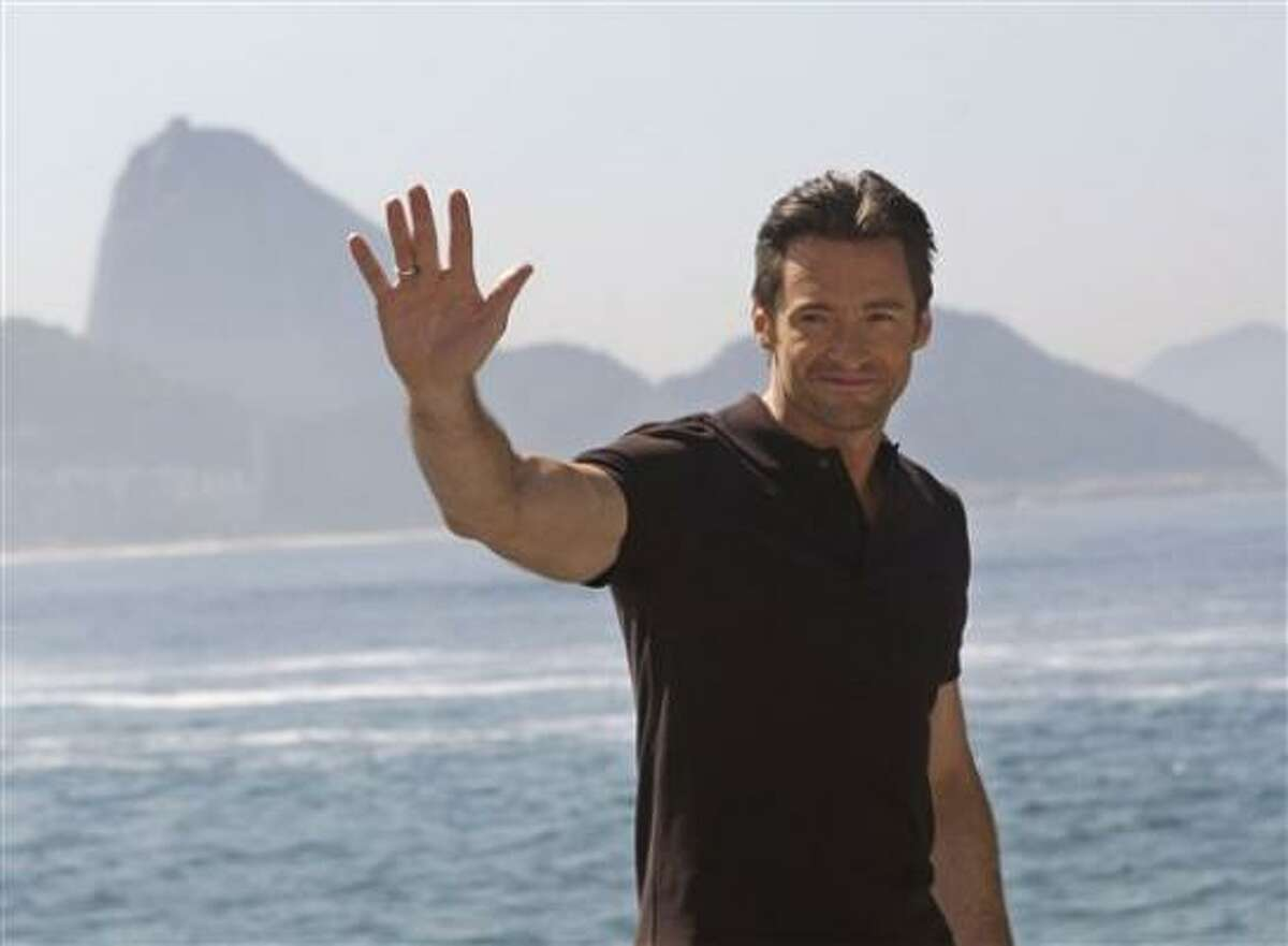 Actor Hugh Jackman greets fans after a press conference at the Forte de Copacabana, back dropped by the Sugar Loaf mountain in Rio de Janeiro, Wednesday, May 6, 2009. Jackman is promoting his new film