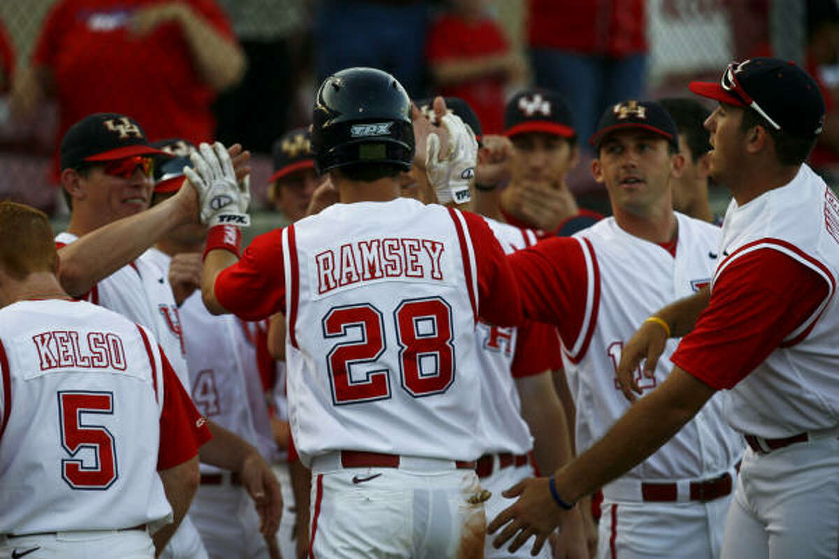 University of Houston's Caleb Ramsey (28) is congratulated by teammates after hitting a solo home run in the third inning.