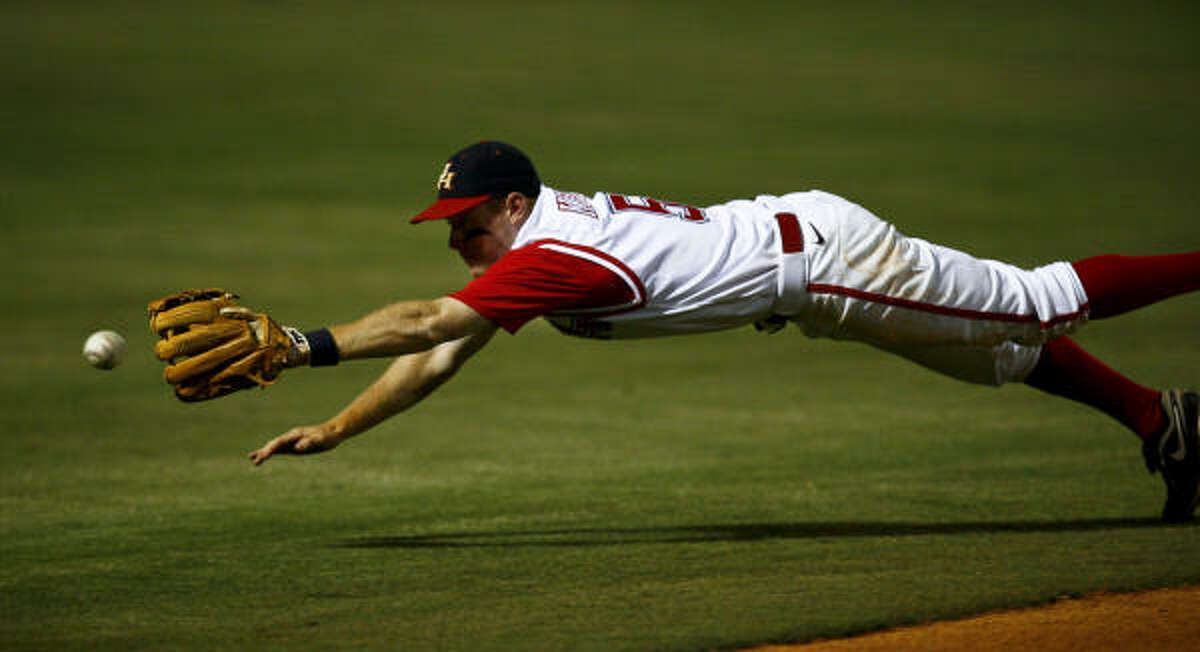 University of Houston infielder Blake Kelso tries to field a ball but comes up short.