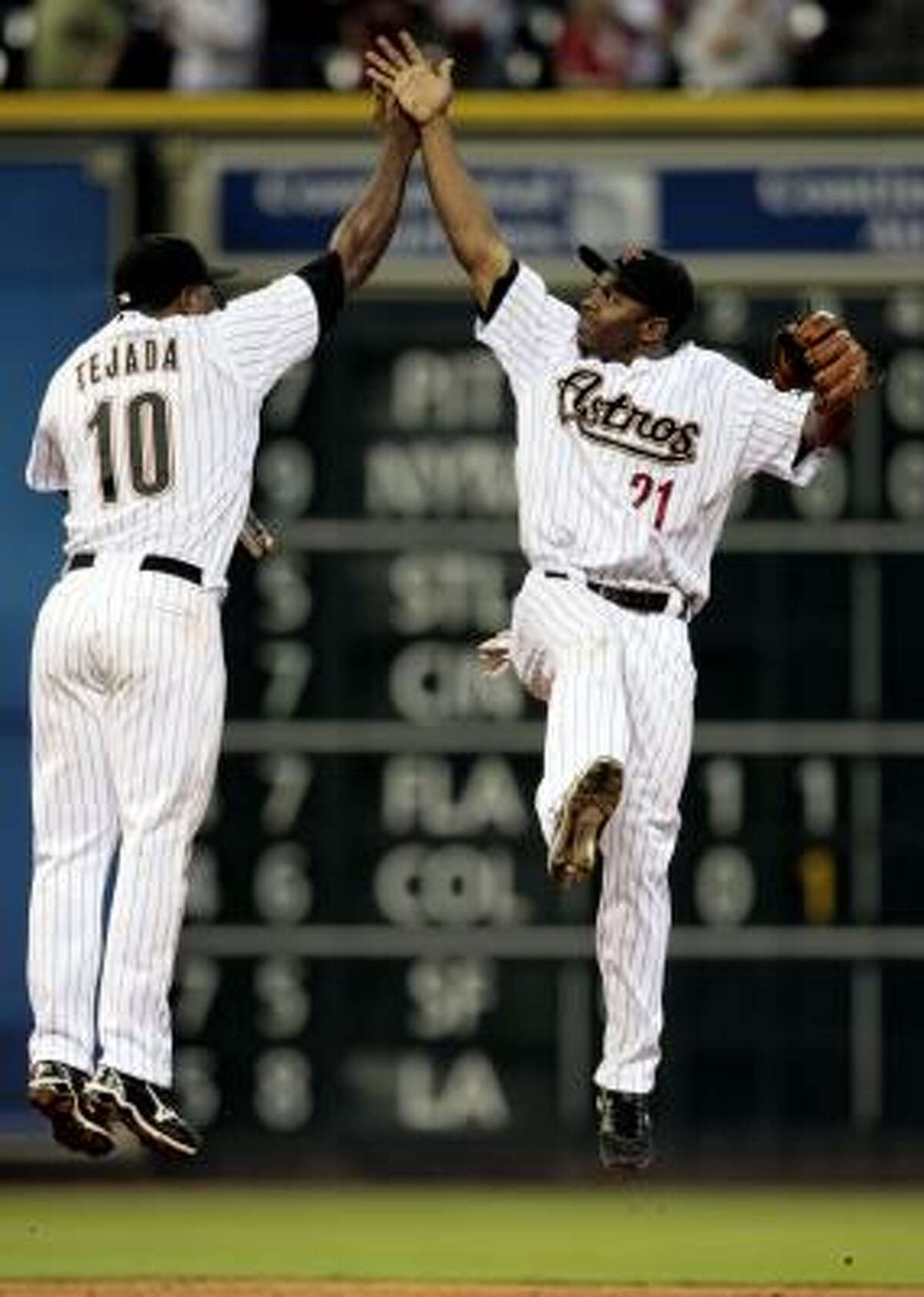 Astros shortstop Miguel Tejada (10) and center fielder Michael Bourn (21) celebrate after the final out.