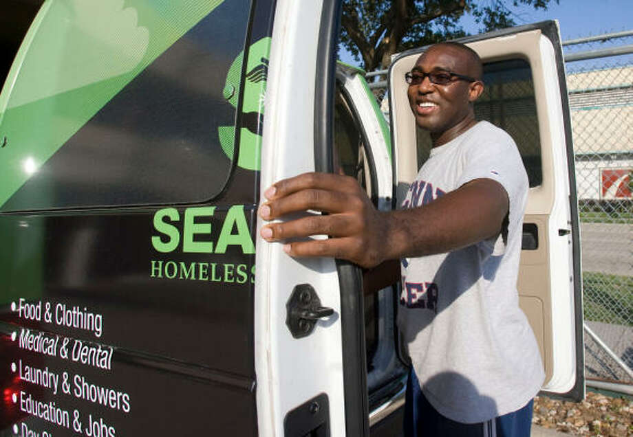 Chilobe Kalambo loads up the SEARCH homeless services van before he and his group start out.  Kalambo, who is getting married this Saturday, decided to celebrate his bachelor party by volunteering with SEARCH homeless services. Photo: Billy Smith II