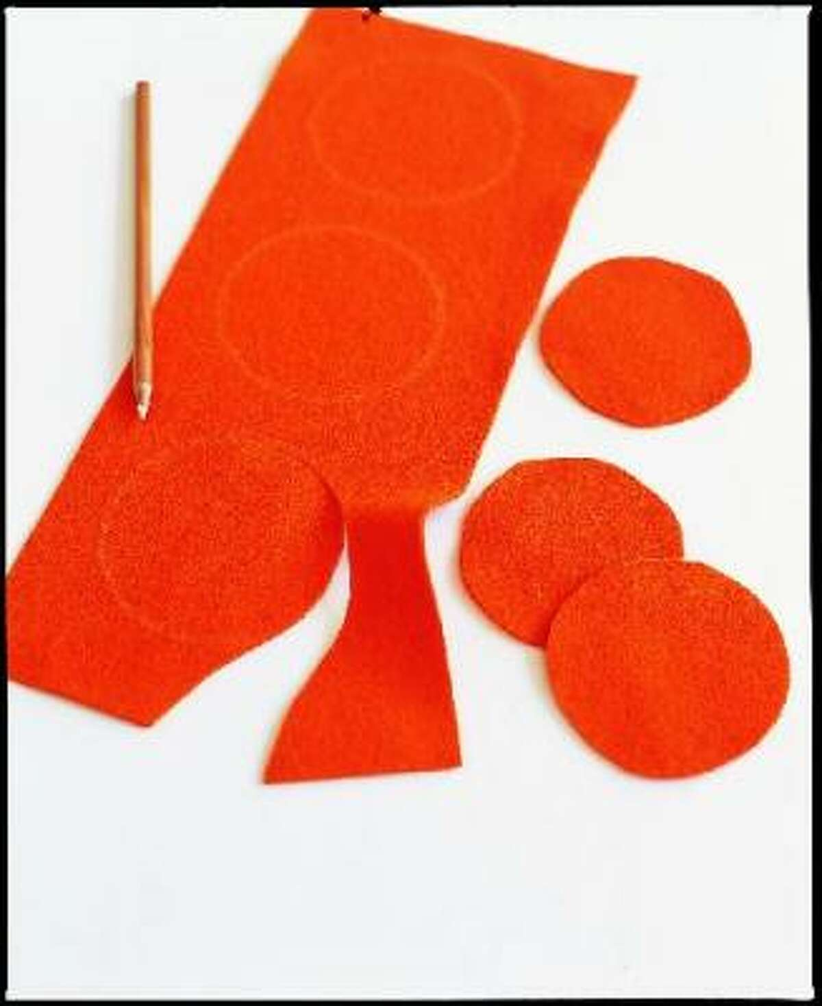 Draw or trace 3-inch circles on felt, then cut them out.