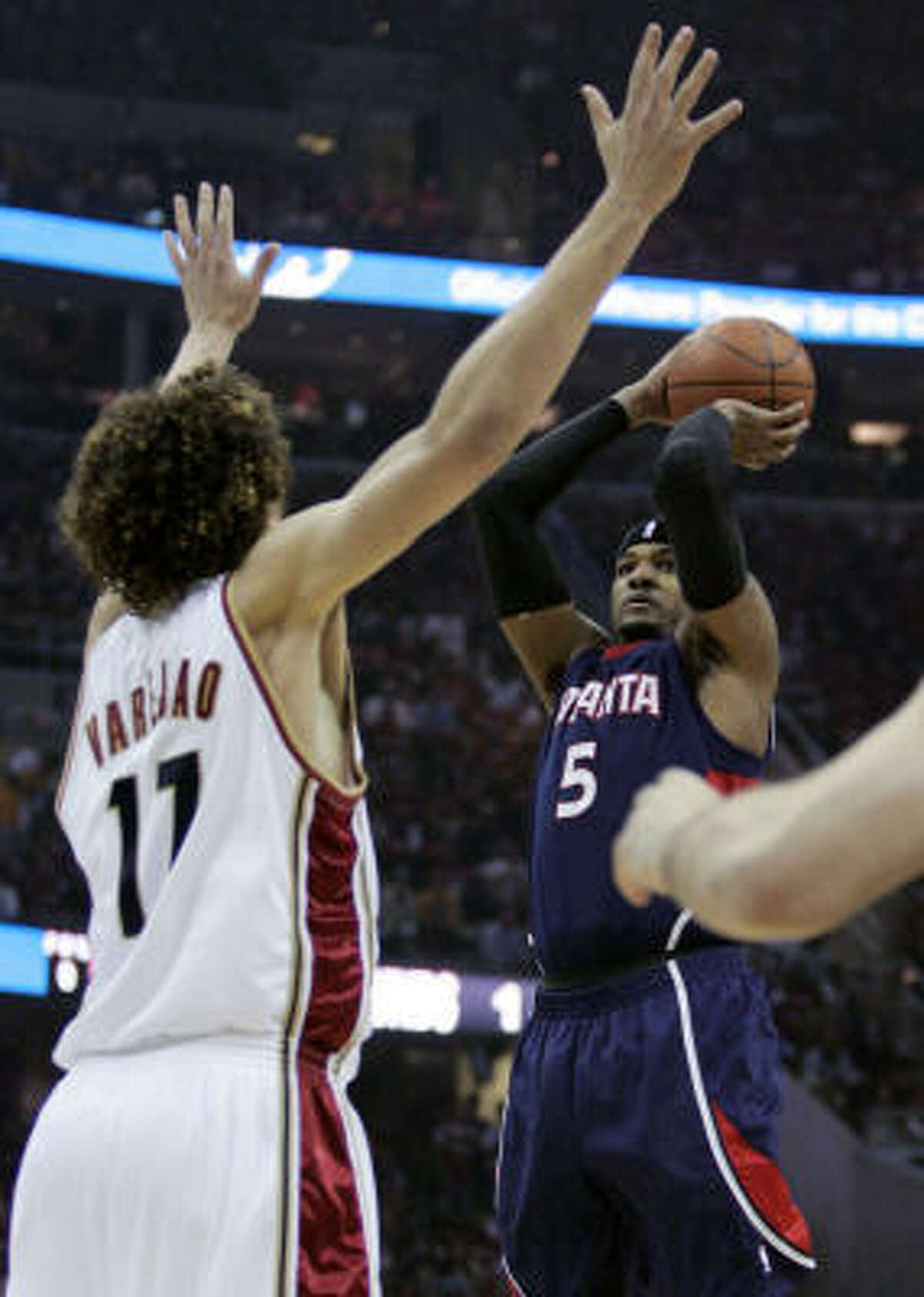 Atlanta's Josh Smith shoots over Cleveland's Anderson Varejao in the first quarter of Game 2 of the Eastern Conference semifinals Thursday in Cleveland.