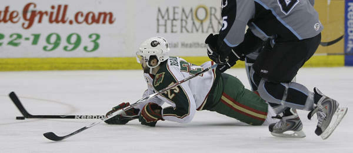 Aeros winger Matt Beaudion (bottom) is upended during the first period.