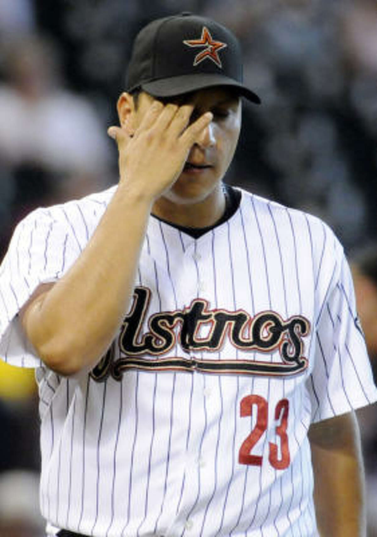 Astros starter Russ Ortiz wipes his brow during the first inning. He was pulled in the third inning.
