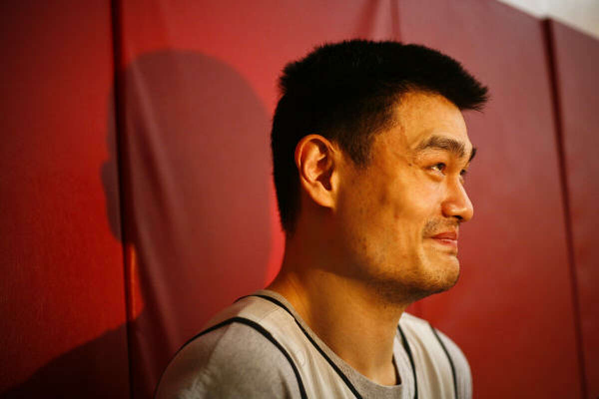 Yao Ming speaks to the media after practice at the Toyota Center.