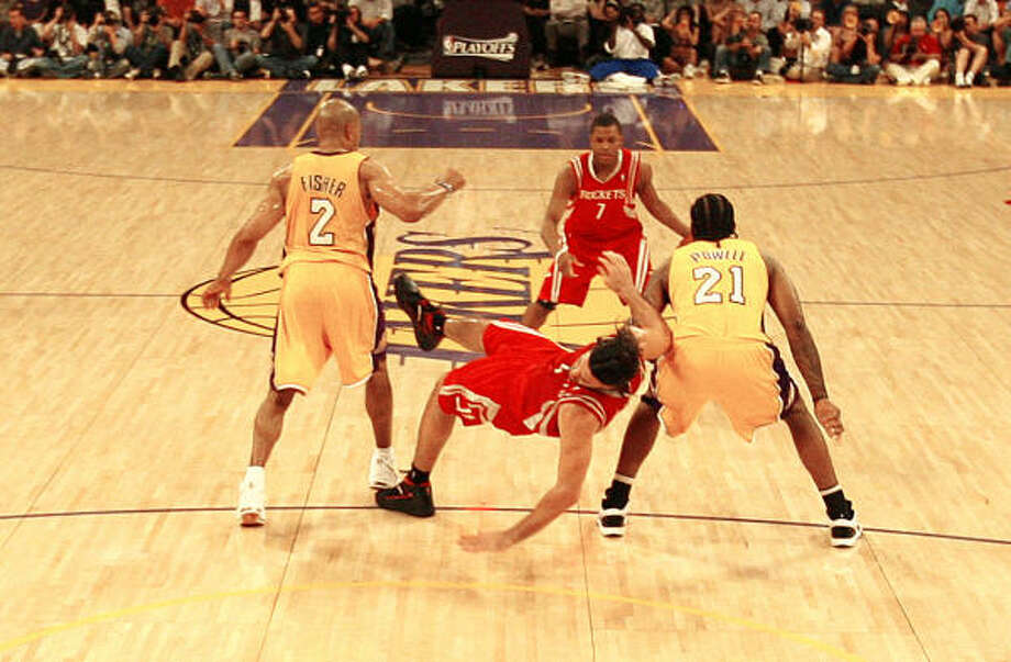 Los Angeles Lakers guard Derek Fisher (2), left, is called for the hard foul on Luis Scola that earned Fisher a one-game suspension. Photo: Nick De La Torre, Chronicle