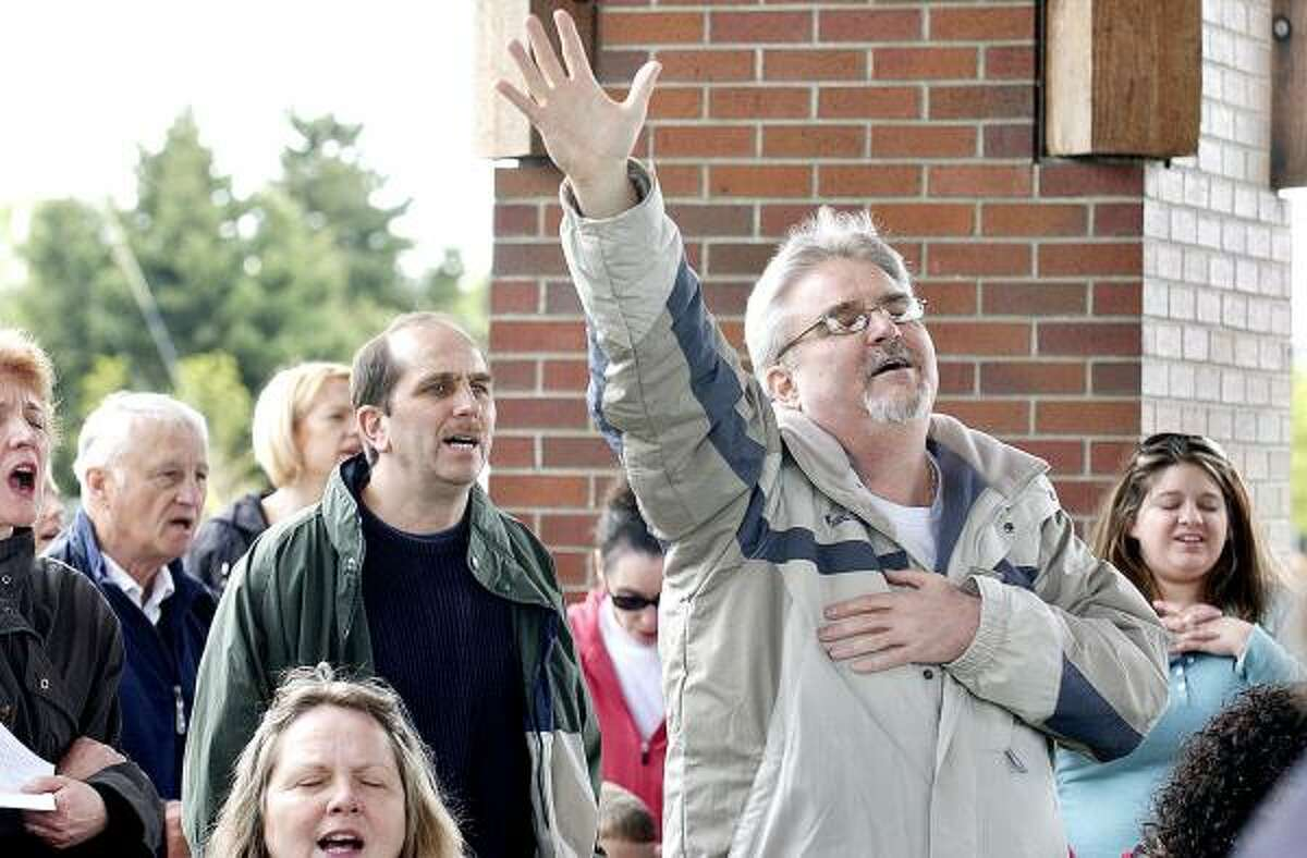 Tom Tilcock, of Salem, takes part in the National Day of Prayer event at the Riverfront Park Pavilion in Salem, Ore., on Thursday.