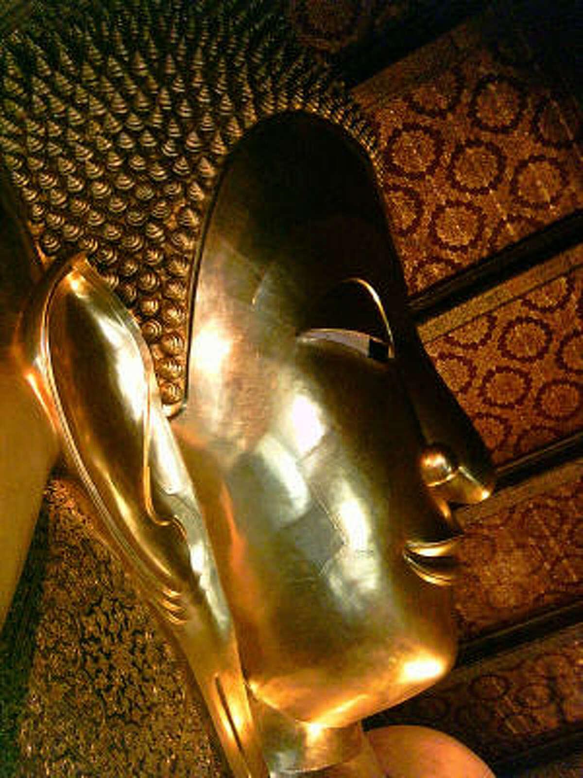 The Reclining Buddha at Wat Po temple near Thailand's Grand Palace in Bangkok.