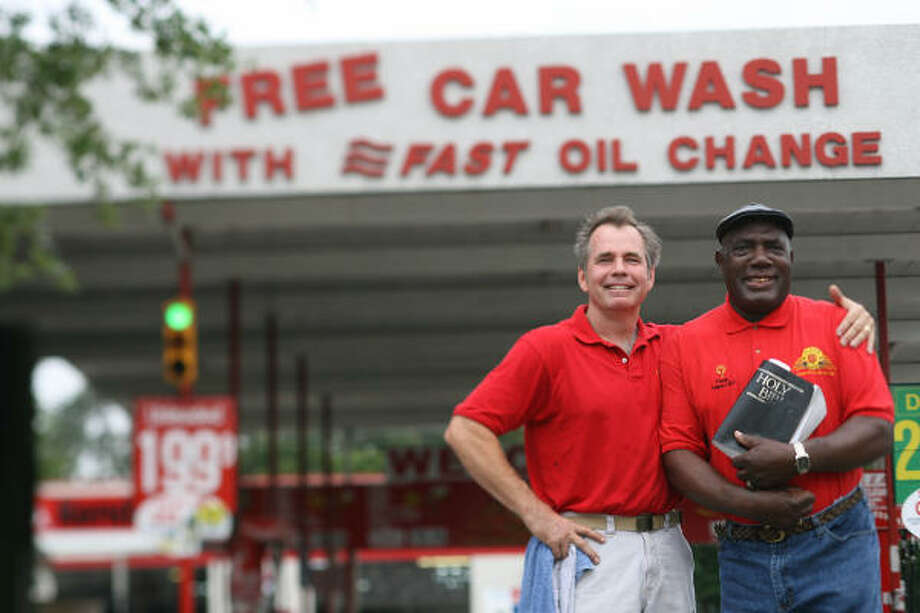 Pastor Charles Cooper of New Hope Missionary Baptist Church and Kevin Jenkins, owner of Dr. Gleem Car Wash and Lube Center, pose in front of the business on Friday, May 1. On Friday mornings, employees gather for Bible study before they begin work. Photo: Mayra Beltran, Chronicle