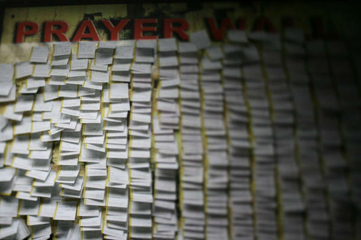 Customer's prayers are posted to the Prayer Wall at Dr. Gleem's Car Wash and Lube Center, where employees gather on Fridays for Bible study before they begin work and free Bibles are offered near the register.