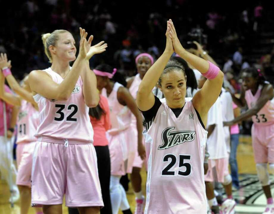 Becky Hammon (25) and Jayne Appel (32) of the Silver Stars acknowledge fans after defeating the Tulsa Shock 72-64 at the AT&T Center on Saturday, Aug. 6, 2011. Photo: Billy Calzada/gcalzada@express-news.net / gcalzada@express-news.net