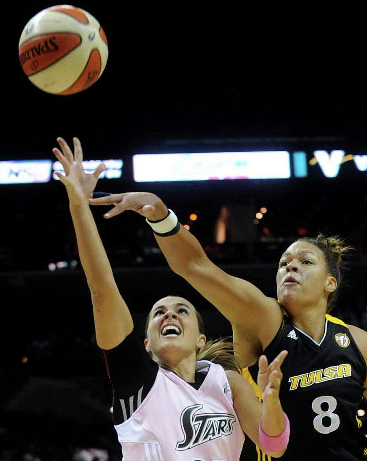 Silver Stars guard Becky Hammon, who's 5-foot-6, shoots as the Tulsa Shock's 6-foot-8 center Elizabeth Cambage at the AT&T Center on Saturday, Aug. 6, 2011. Hammon had 19 points in the Stars' 72-64 win over the Shock.