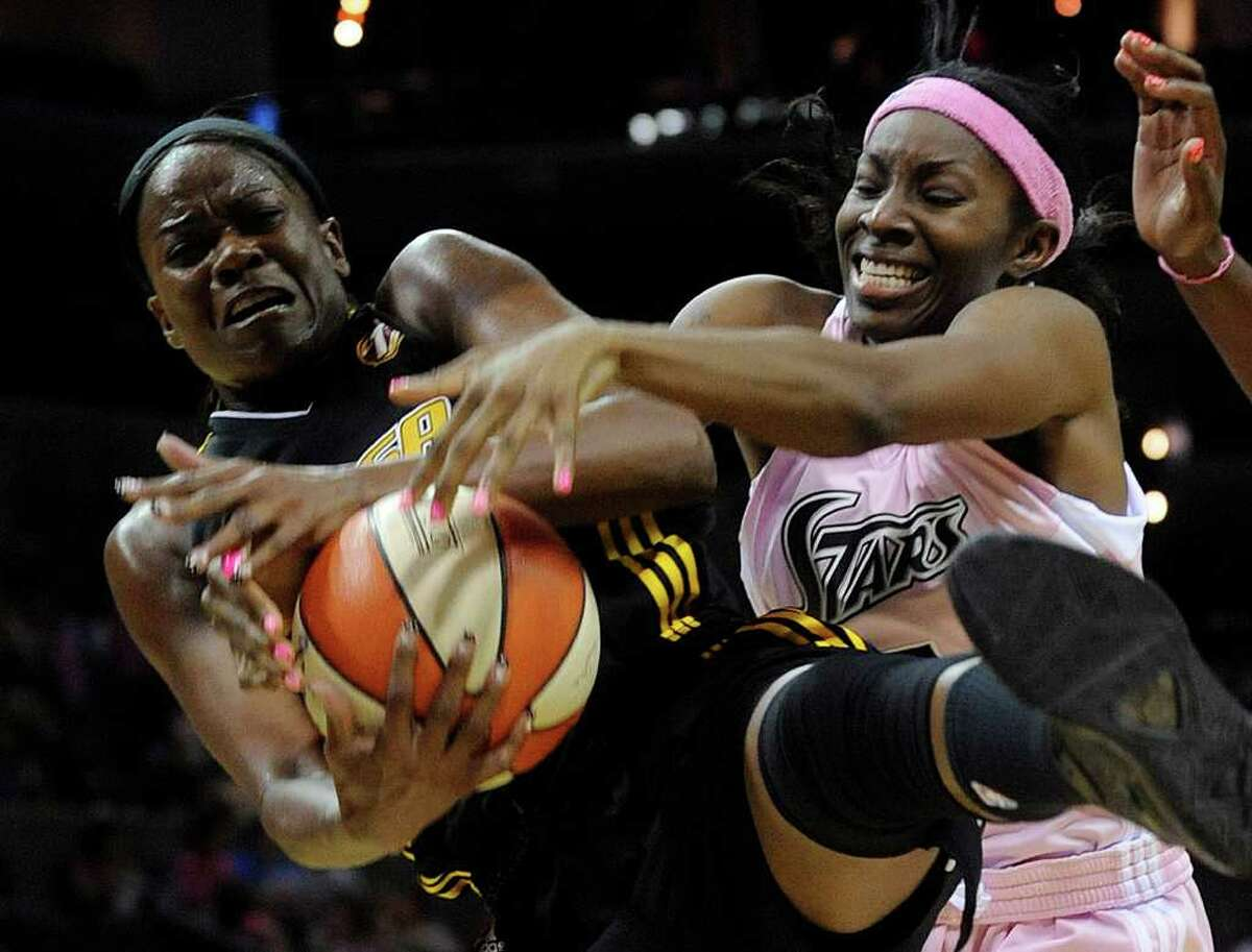 Silver Stars forward Scholanda Robinson battles the Tulsa Shock's Sheryl Swoopes defends for a rebound during the first half at the AT&T Center on Saturday, Aug. 6, 2011. Robinson had 12 points in the Stars' 72-64 win over the Shock.
