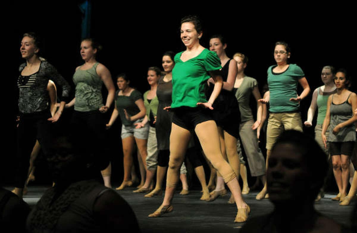 CHS GOLDEN GIRLS: Brooke Massengale, center, a junior, and the Conroe High School Golden Girls perform their