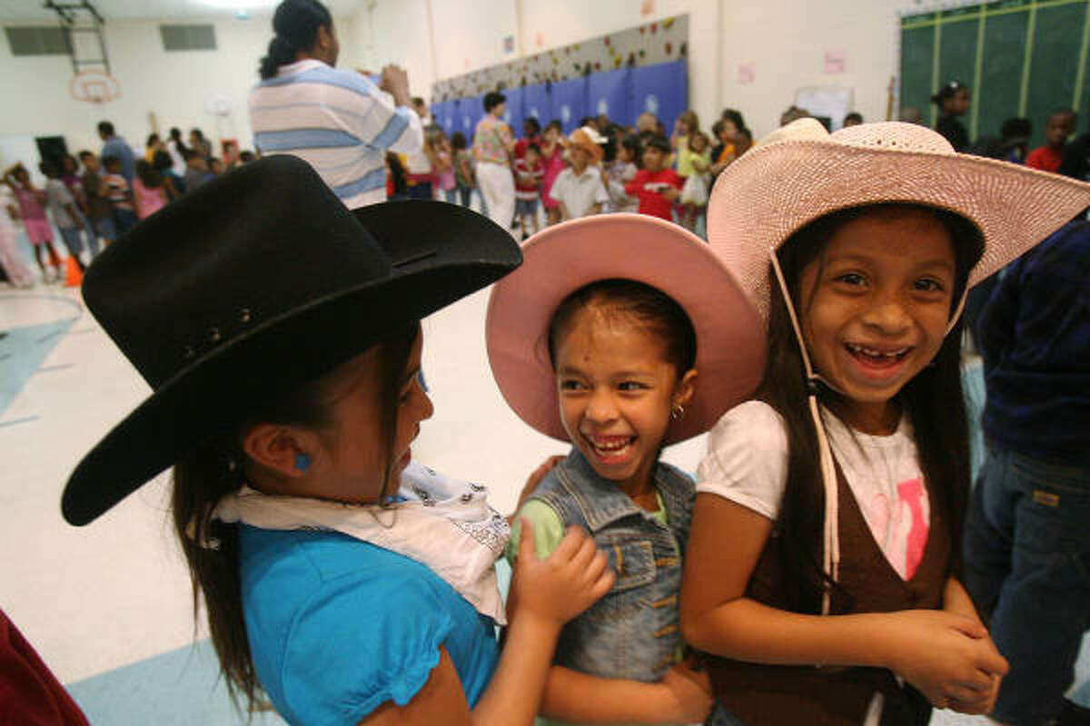 Karen Rodriguez, Idali Rodriguez and Carla Sanchez line up to go to class after the Cinco de Mayo program at Heights Elementary School. It's a popular misconception that Cinco de Mayo is Mexico's Independence Day. The date actually celebrates the 1862 Battle of Puebla.