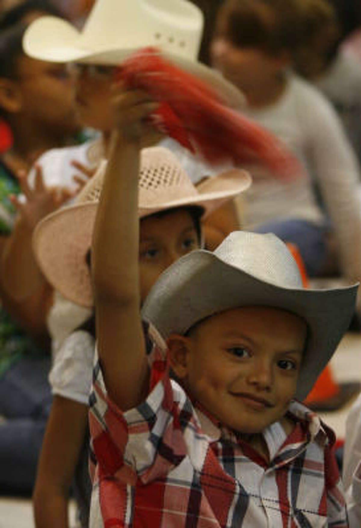 Marlo Alvarado cheers for the mariachis in Texas City.