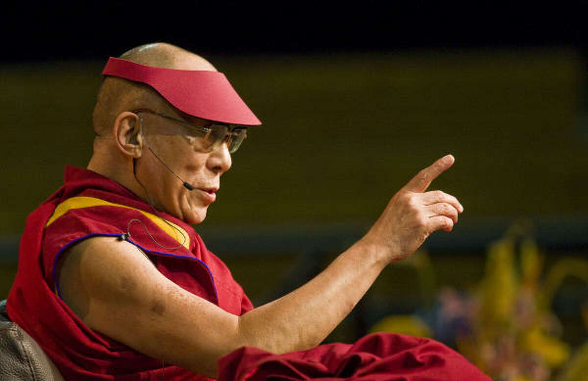 The Dalai Lama delivers a lecture on Sunday, April 20, 2008, at the University of Michigan in Ann Arbor, Mich. During his lecture, dubbed