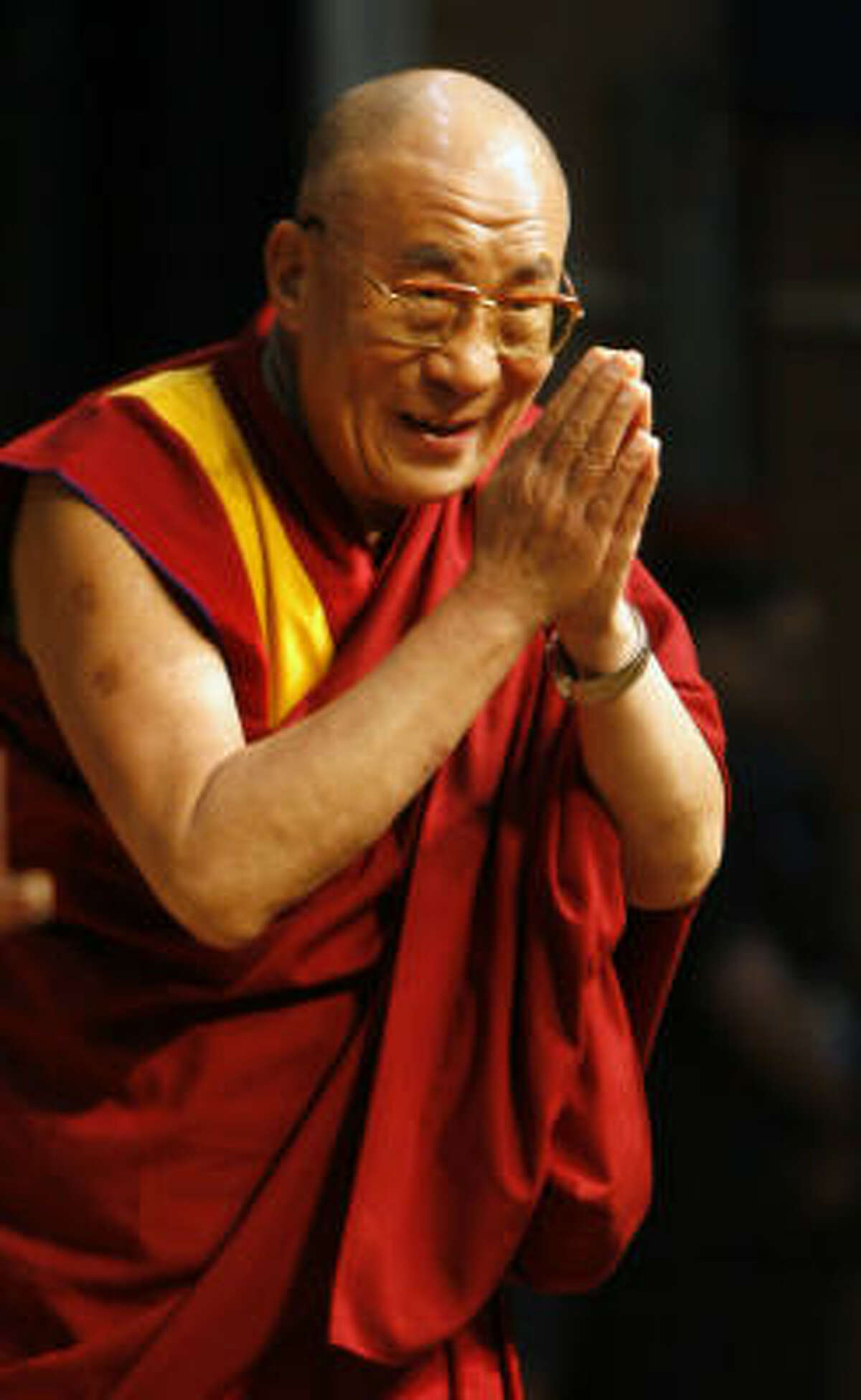His Holiness the 14th Dalai Lama Tenzin Gyatso greets the crowd at Rice University's Autry Court Tuesday, May 1, 2007, in Houston.