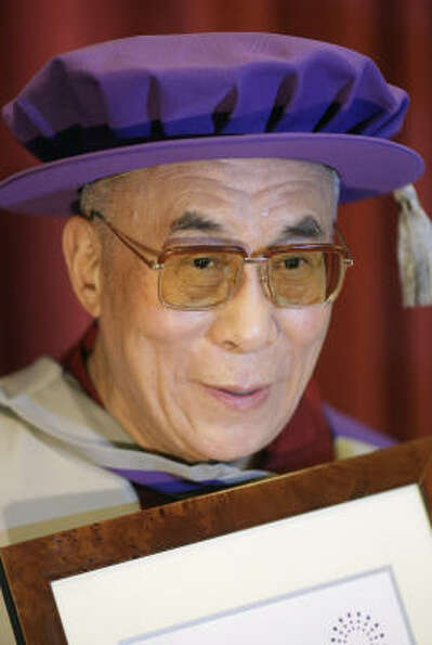 Tha Dalai Lama receives an honorary doctorate from the London Metropolitan University in central Lon