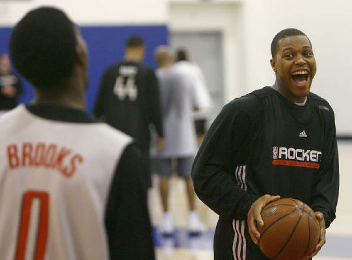 Rockets guard Kyle Lowry jokes with guard Aaron Brooks during practice.