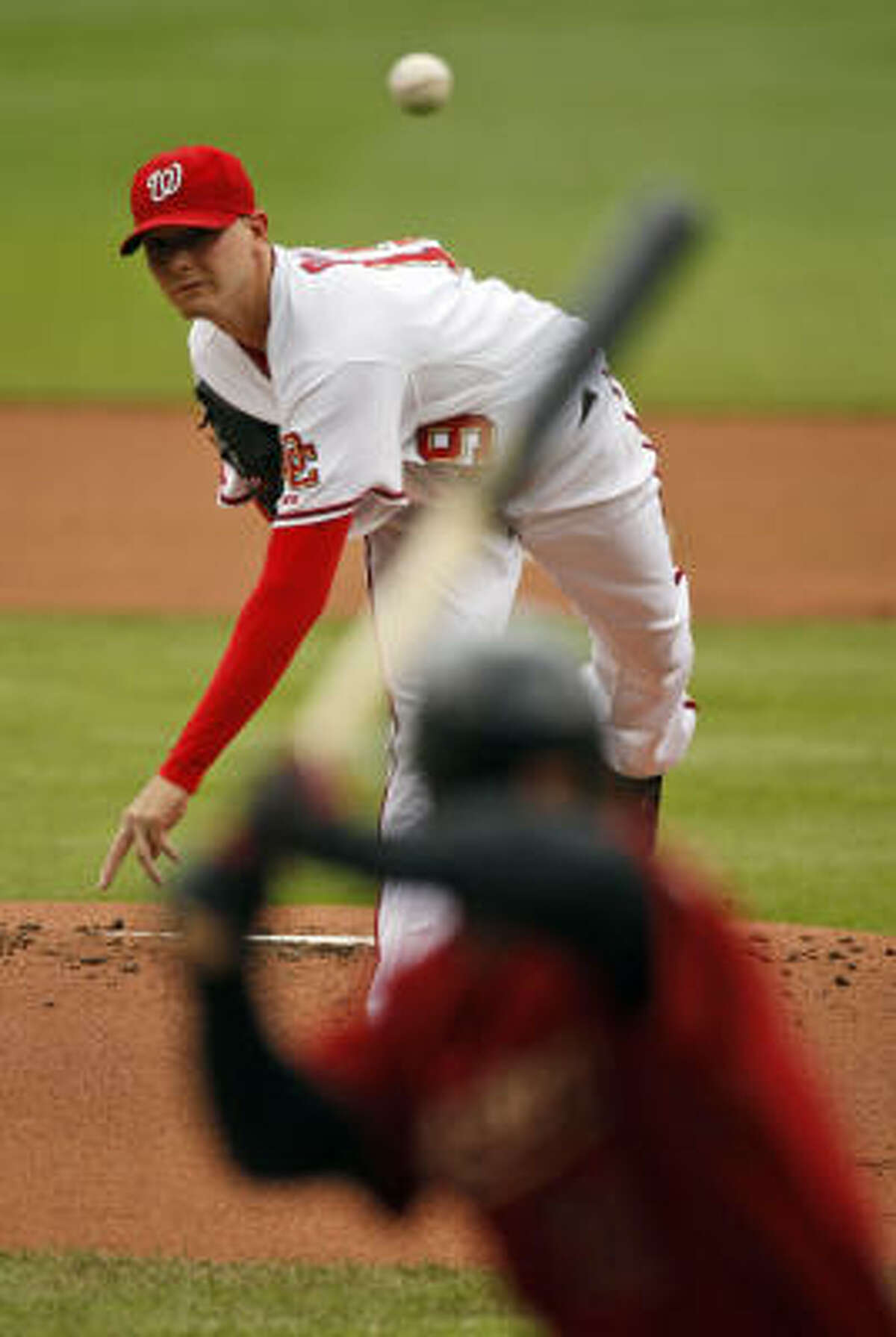 Nationals lefthander Scott Olsen throws against Astros outfielder Michael Bourn during the first inning.