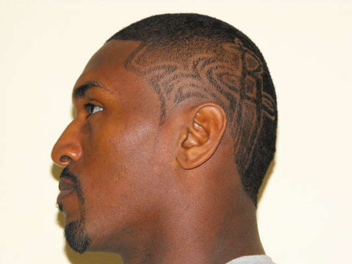 September, 2008: Ron Artest becomes a Rocket and brings more than defense to Houston. He sports hairstyles that will have cameras flashing.