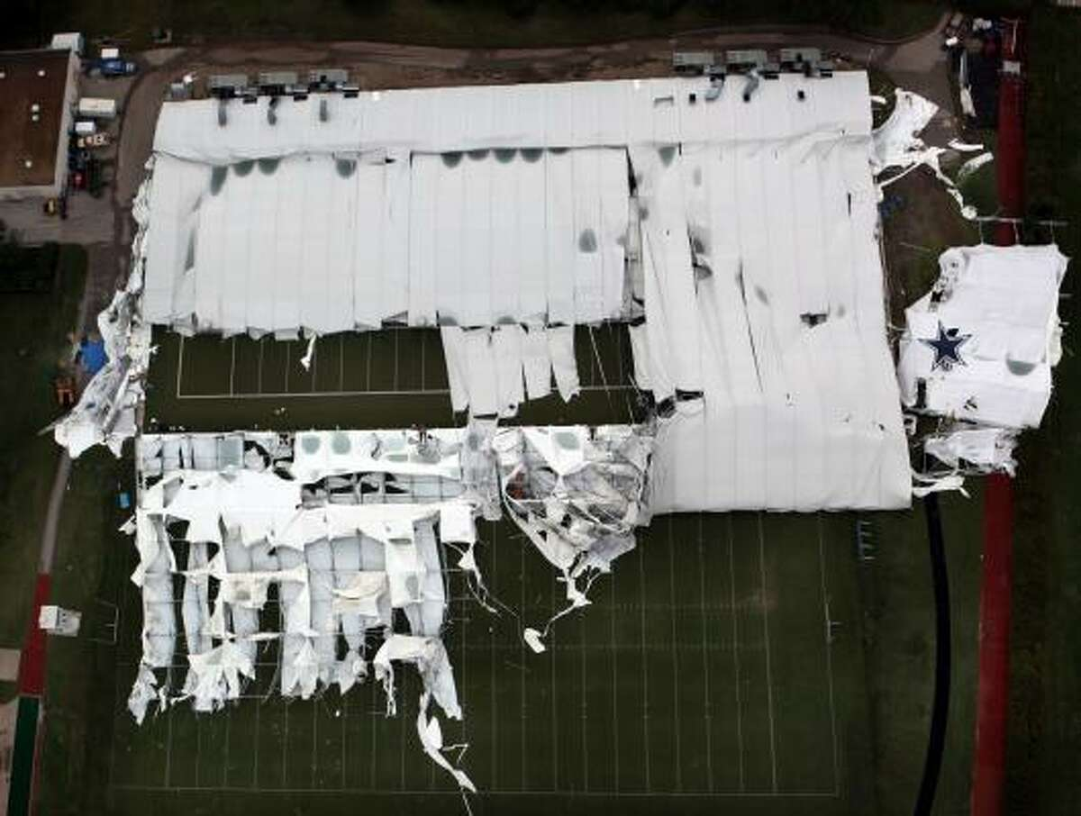 An aerial view of the Dallas Cowboys indoor practice facility shows the extent of the damage done to the roof during a storm Saturday, May 2.