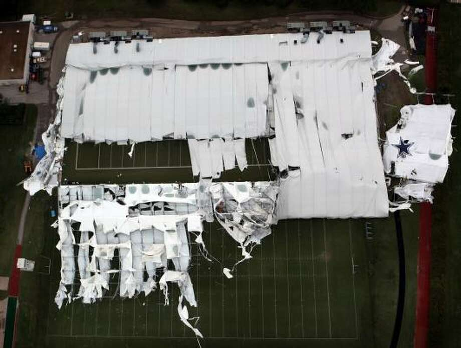 An aerial view of the Dallas Cowboys indoor practice facility shows the extent of the damage done to the roof during a storm Saturday, May 2. Photo: David Woo, AP