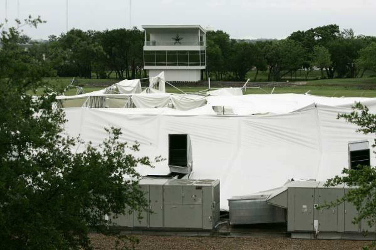 The remains of the Dallas Cowboys' practice field bubble lie on the ground after high winds caused the structure collapsed during a storm Saturday.
