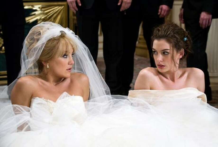 'Bride Wars,' 2009. Anne Hathaway made it on this list yet again. This time, two BFFs start warring when they accidentally booked their dream weddings for the same time/date/place. Clearly the only way these two women can resolve the issue is to start sabotaging each others big day. Obviously. Photo: Claire Folger, AP