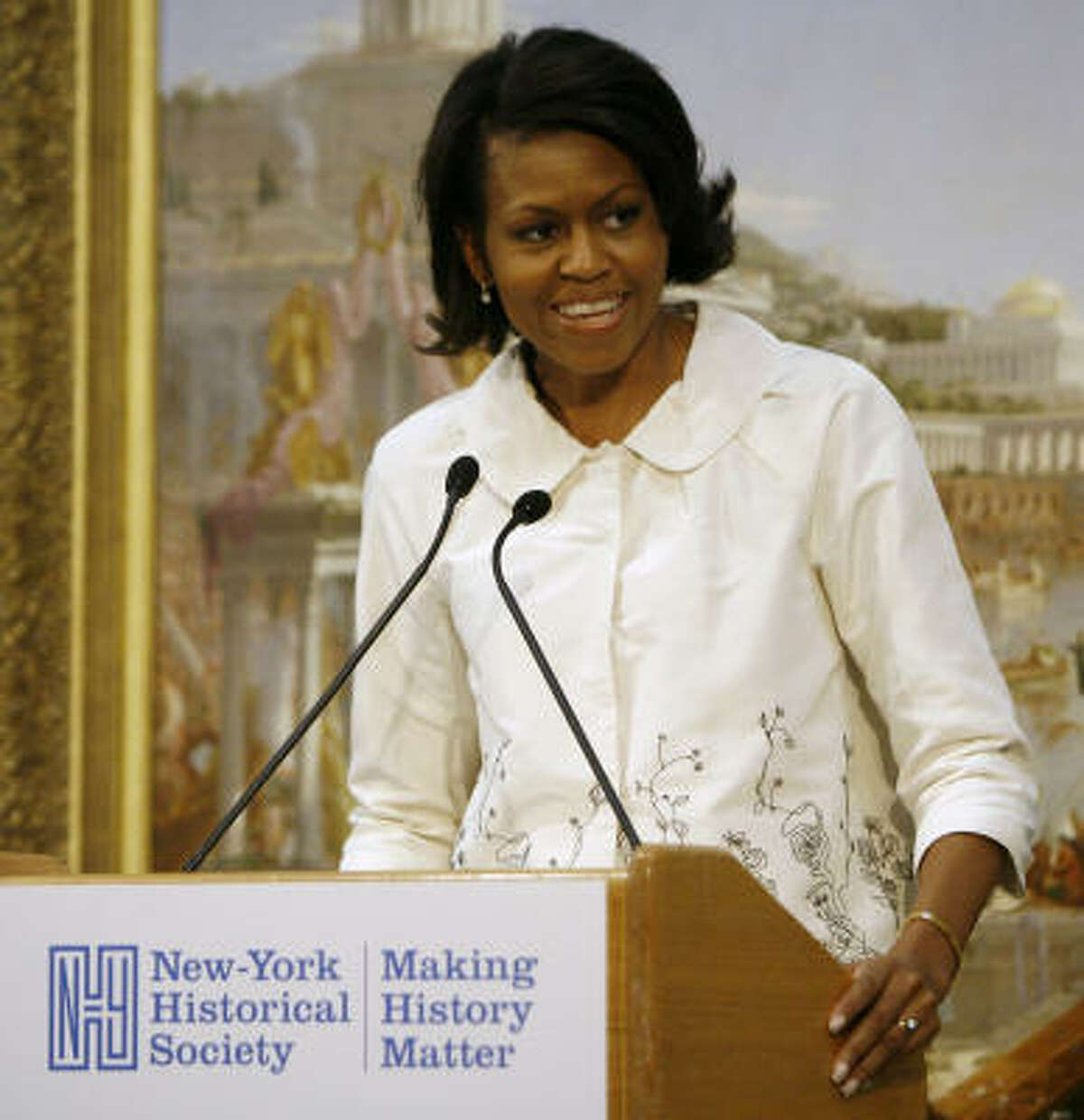 Some call Michelle Obama's style classic, like Jackie O, but with a twist.