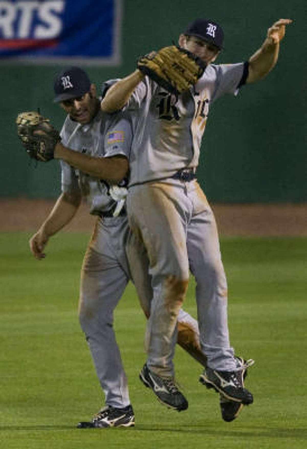 Rice's Chad Mozingo, right, and Michael Fuda celebrate the final out in the Owls' 7-5 win.