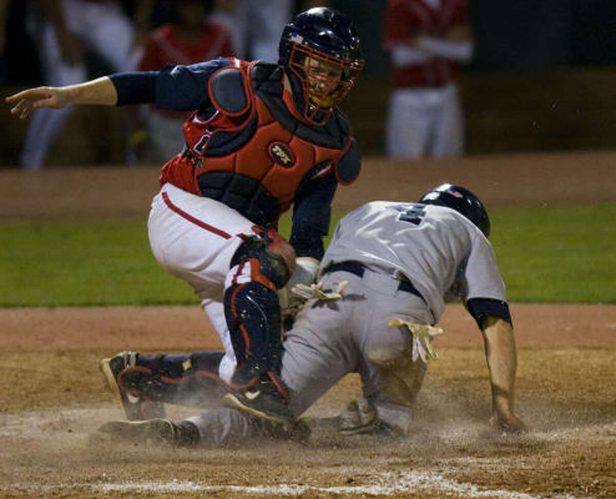 Rice's Chad Mozingo scores past the tag from UH catcher Chris Wallace for what turned out to be the deciding run in the top of the ninth inning.